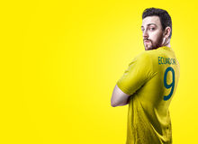 Ecuadorian soccer player player on yellow background Stock Image