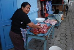 Ecuadorian woman cutting meat stock image