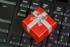 Ed gift box on computer keyboard in online shopping concept Stock Photo