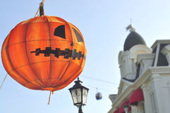 Ed Halloween lantern is hanging beside a castle in the Vinpearland royalty free stock photo