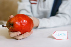 Ed pear with human hand Royalty Free Stock Images