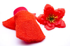 Ed washcloth with blossom. Red washcloth with blossom on white background Royalty Free Stock Photos
