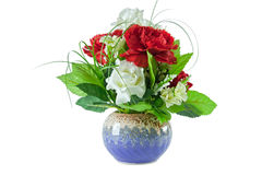 Ed and white roses bouquet in blue vase Stock Photos