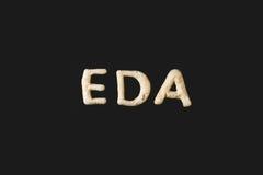 Eda Topword сделанное от изолированного теста печенья на черноте Стоковые Изображения RF