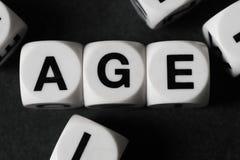Edad de la palabra en los cubos del juguete Fotos de archivo libres de regalías