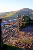 Peak district, Derbyshire, UK. Edale, Derbyshire, UK. January 07, 2018. A closed frosted five bar gate across the old Roman road, now a farmtrack on the slopes Royalty Free Stock Image