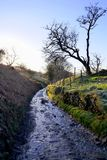Roman road, Derbyshire, UK. Edale, Derbyshire, UK. January 07, 2018. A ice covered old Roman road, now a farmtrack on a cold frosty morning in January on the Stock Images