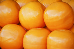 Edam. Is a Dutch cheese traditionally sold in spheres with a pale yellow interior and a coat of red paraffin wax Stock Photo