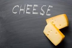 Edam cheese on blackboard Royalty Free Stock Image