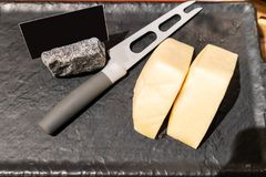 Edam cheese. On black stone plate in buffet line royalty free stock photo