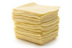 Edam cheese. Sliced fresh edam cheese on white background, cow cheese stock photos