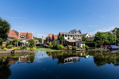 Edam colorful houses reflected in the water, with a nice blue sky royalty free stock image
