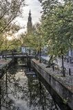 Canal and church in autumn royalty free stock photos