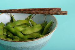 Edamame. Bowl of healthy edamame or soybeans; healthy vegetable snack; chopsticks stock photos