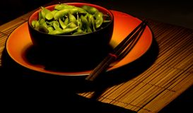 Edamame B. Japanese steamed edamame soybeans displayed in a stoneware bowl with chopsticks Royalty Free Stock Image