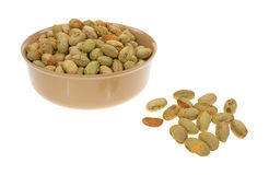 Edamame in bowl with separate nuts Royalty Free Stock Image
