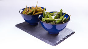 Edamame of Japanese steamed soyal beans in blue chinese bowl on Royalty Free Stock Photography
