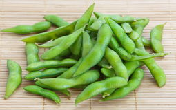 Edamame nibbles, boiled green soy beans Stock Image