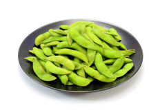 Edamame nibbles, boiled green soy beans, japanese Royalty Free Stock Photo