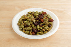 Edamame with nuts and dried fruit on white plate Royalty Free Stock Photo