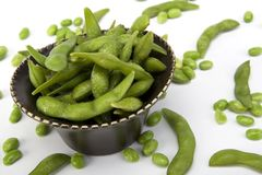 Edamame soy beans in a brown ceramic dish Royalty Free Stock Photos