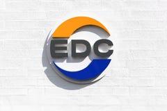 Edc-logo p? en v?gg royaltyfri bild