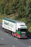 Eddie Stobart lorry branded Stobart biomass. Eddie Stobart lorry on M6 motorway in the countryside in the slow lane. The lorry has Stobart biomass supplying stock photography