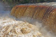Eddy Beneath Flooded Falls dramático fotos de stock royalty free