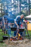 Man cooking on open fire stock images