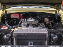 Edelbrock engine block sitting in a classic Chevy car royalty free stock photo