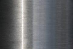 Edelstahlhintergrund mit einem Streifen des Lichtes stockbild