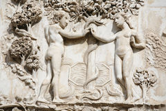 Eden. Adam and Eve in the Garden of Eden in front of the tree of knowledge. Detail from the ornate of the facade - Orvieto Cathedral, Umbria, Italy stock photo