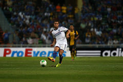 Eden hazard. SHAH ALAM - JULY 21: Chelsea Football Club player Eden Hazard (white jersey) passes the ball in a friendly match with the Malaysian national team in stock images