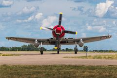 Hawker Sea Fury FB-11. EDEN PRAIRIE, MN - JULY 16 2016: Hawker Sea Fury FB-11 `Sawbones` turns onto taxiway. The Sea Fury was a British fighter aircraft Royalty Free Stock Photo