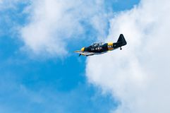 AT-6 Texan Flies By. EDEN PRAIRIE, MN - JULY 16, 2016: AT-6 Texan flies by at air show. The AT-6 Texan was primarily used as trainer aircraft during and after Stock Images