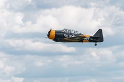 AT-6 Texan Flies By Gear Up. EDEN PRAIRIE, MN - JULY 16, 2016: AT-6 Texan flies by with gear up at air show. The AT-6 Texan was primarily used as trainer Royalty Free Stock Images