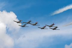 Seven AT-6 Texans Fly Away. EDEN PRAIRIE, MN - JULY 16, 2016: AT6 Texan planes fly away at air show. The AT6 Texan was primarily used as trainer aircraft during Stock Photography
