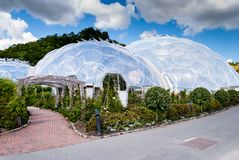 Flower beds outside geodesic biome domes at the Eden Project. The Eden Project is a visitor attraction in Cornwall, England royalty free stock images