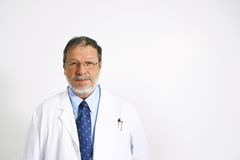 Ederly doctor. Mature doctor with beard on a white background Royalty Free Stock Images