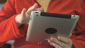 Ederly woman holding an electronic tablet stock footage