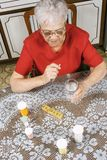 Ederly woman taking pills Royalty Free Stock Photography