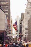 Edestrians making their way down East 42nd Street in Manhattan, NY. Royalty Free Stock Image