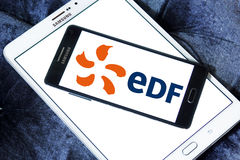 Edf energy company logo. Logo of energy and home services company edf on samsung mobile phone a5 on samsung tablet stock image