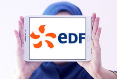 Edf logo. Logo of energy and home services company edf on samsung tablet holded by arab muslim woman stock image