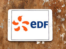 Edf logo. Logo of energy and home services company edf on samsung tablet on wooden background royalty free stock image