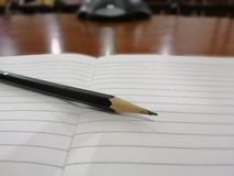 Pencil on the paper, Writing book. Edf pencil paper writing book royalty free stock photos