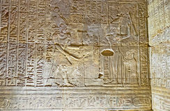 The Edfu Drama. EDFU, EGYPT - OCTOBER 7, 2014: The walls of the Horus Temple decorated with the scenes of the Edfu Drama, named Triumph of Horus, on October 7 in Royalty Free Stock Image