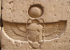 Edfu temple, Egypt, Africa. Winged scarab beetle carved on top of door of Edfu temple Stock Photography