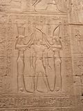 Edfu temple, Egypt, Africa. Bas-relief with goddesses and pharao royalty free stock photo