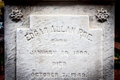 Edgar Allan Poe Tombstone. Tombstone at Edgar Allan Poe gravesite with name and dates engraved Stock Images